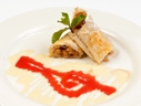 Pear and apple strudel from Phyllo dough in vanilla-strawberry Bechamel sauce